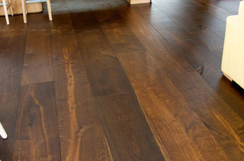 Pose de parquet flottant stratifie et massif renovation for Parquet sur carrelage existant