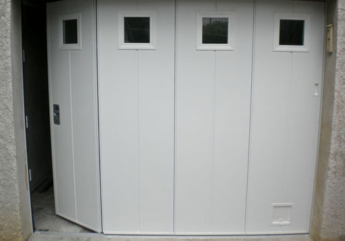Installer une porte de garage manuelle ou electrique a for Installer une porte exterieure