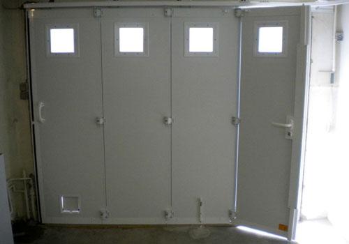 Installer une porte de garage manuelle ou electrique a for Porte de garage electrique
