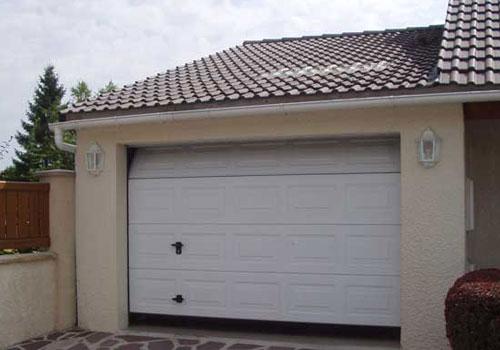 Porte garage electrique - Installer une porte de garage sectionnelle ...